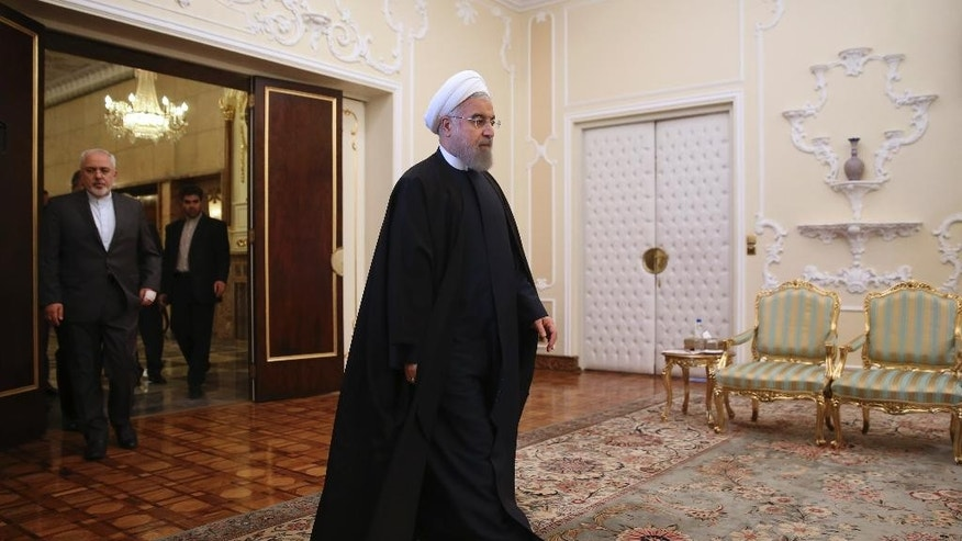 FILE - In this April 17, 2016 file photo, Iranian President Hassan Rouhani arrives for a meeting with Indian Foreign Minister Sushma Swaraj at the presidency office in Tehran, Iran. Iranian state TV says that the moderate-reformist bloc has secured more than 20 more seats in parliamentary runoff elections, bringing the bloc closer to a majority in the next legislature. State TV on Saturday, April 30, 2016, announced winners for 45 of the remaining 68 seats being contested. Among them there are 23 moderate-reformist candidates who support Rouhani and a nuclear deal the country reached with world powers last summer. (AP Photo/Vahid Salemi, File)