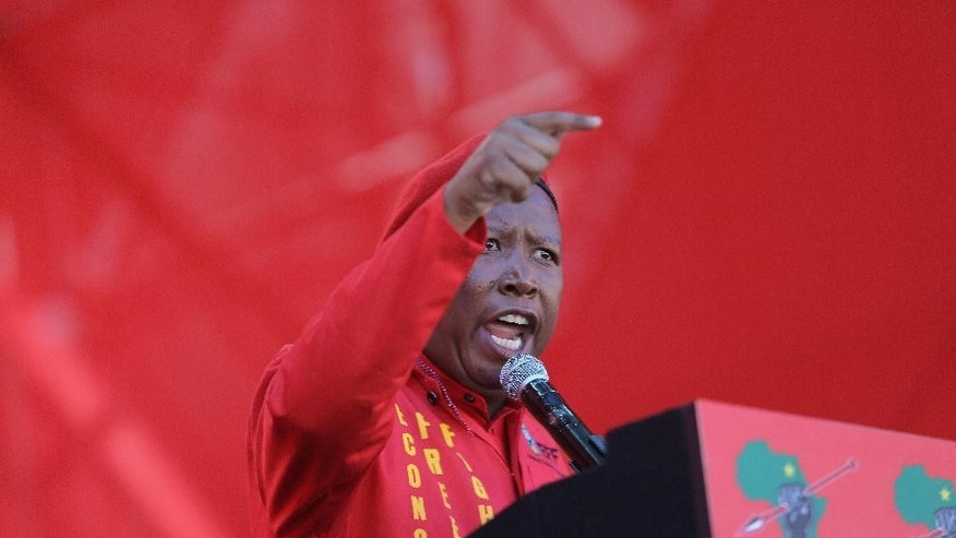 Economic Freedom Fighters (EFF) party leader, Julius Malema, addresses supporters at the launch of their municipal election manifesto in Soweto, Saturday, April 30, 2016. Fiery South African opposition politician Malema told 40,000 cheering supporters that President Jacob Zuma should step down before the army turns on him because of the corruption allegations against him.(AP Photo/Denis Farrell)