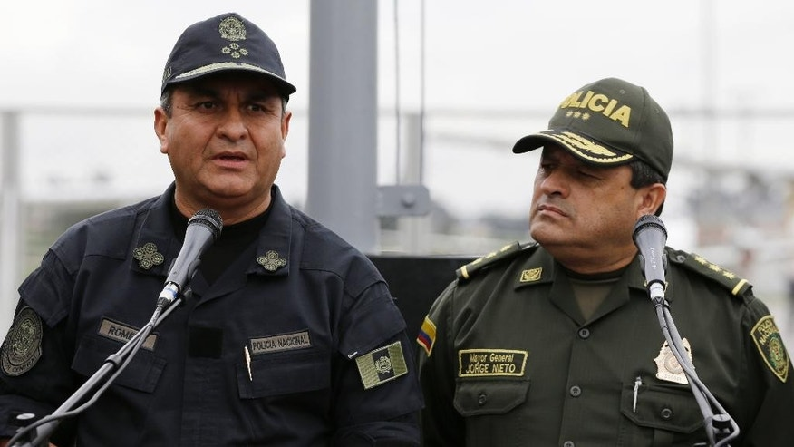 Peru's Chief of Police Vicente Romero, left, and Colombia's National Police Chief Jorge Nieto talk to the media during a press conference in Bogota, Colombia, Sunday, May 1, 2016. Romero said that alleged Peruvian drug trafficker Gerson Galvez was captured by Colombian National Police in Medellin on Saturday. (AP Photo/Fernando Vergara)