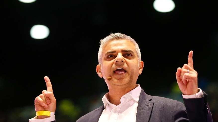 In this April 28, 2016 photo, Candidate for London Mayor Sadiq Khan speaks during an assembly at the London Mayor election event of London Citizens in London. In the race to become London's next mayor, one candidate is a bus driver's son who grew up in social housing, the other a billionaire's son raised in a mansion. They are two very different London success stories, and one is about to become mayor of Europe's largest city. The contrast between Labour's Sadiq Khan and Conservative candidate Zac Goldsmith is resonant in a city where soaring property prices are increasing income disparities.(AP Photo/Frank Augstein)