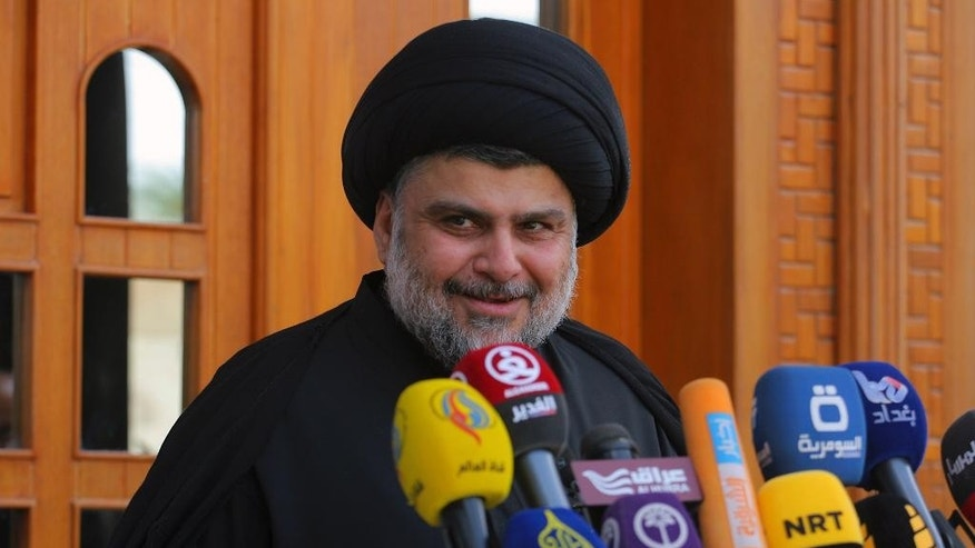 Shiite cleric Muqtada al-Sadr speaks during a media conference in Najaf, Iraq, 100 miles (160 kilometers) south of Baghdad, Saturday, April 30, 2016. Dozens of supporters of Muqtada al-Sadr protesting against the government, stormed into the heavily fortified Green Zone in Baghdad on Saturday to storm parliament in what is being seen as a major escalation of the political crisis. (AP Photo/Karim Kadim)