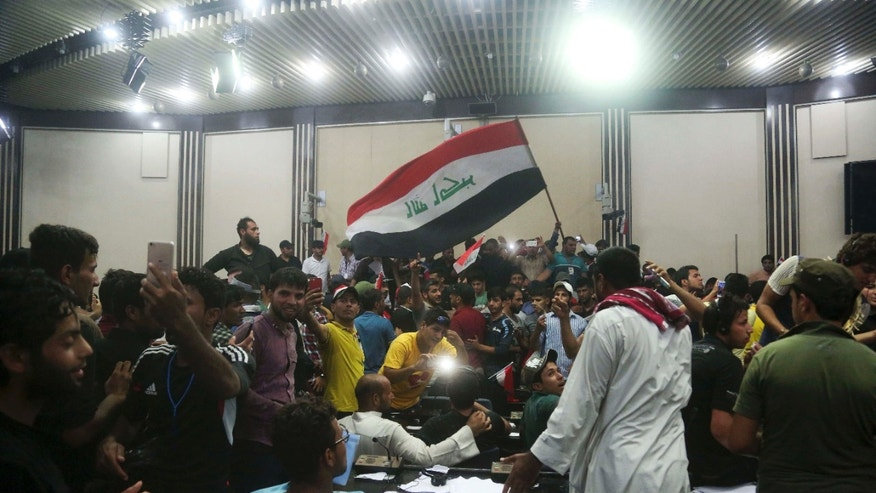 April 30, 2016: Supporters of Shiite cleric Muqtada al-Sadr storm parliament in Baghdad's Green Zone.