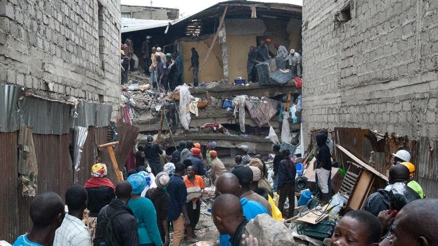 People help survivors retrieve their household items at the site of a building collapse in Nairobi, Kenya, Saturday, April 30, 2016.  A six-storey residential building in a low income area of the Kenyan capital collapsed Friday night under heavy rain and flooding, killing at least seven people and injuring over 100 others, Kenyan officials said. (AP Photo/Sayyid Abdul Azim)