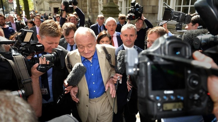 Former mayor of London Ken Livingstone, centre, is surrounded by media outside Millbank in Westminster, London, Thursday April 28, 2016. Britain's main opposition Labour Party has suspended former London Mayor Ken Livingstone over comments about anti-Semitism. Livingstone, who sits on Labour's National Executive Council, said in a radio interview that he had never heard any anti-Semitic views expressed by Labour members, and claimed Adolf Hitler had supported Zionism before the Holocaust. (Anthony Devlin/PA via AP) UNITED KINGDOM OUT