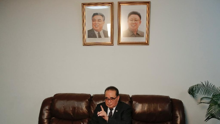 "FILE - In this Saturday, April 23, 2016 file photo, seated under portraits of former North Korean leaders, Kim Il Sung, left, and Kim Jong Il, North Korea's Foreign Minister Ri Su Yong answers questions during an interview at the country's Permanent Mission to the United Nations in New York. North Korea is preparing to hold a once-in-a-generation congress of its ruling party that is intended to rally the nation behind leader Kim Jong Un and could provide an important glimpse into Kim's plans for the country's economy and military. ""One of the most important things through this party congress is to show to the entire world the union of our people,"" Ri told the AP while he was in New York for a United Nations conference on climate change. (AP Photo/Julie Jacobson, File)"