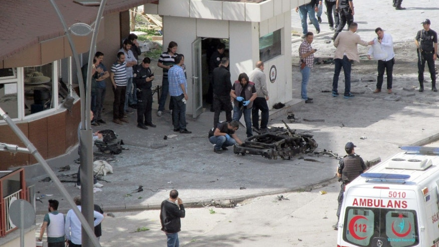 May 1, 2016: Security and forensic officials and medics investigate after an explosion outside the Police headquarters in Gaziantep, Turkey.