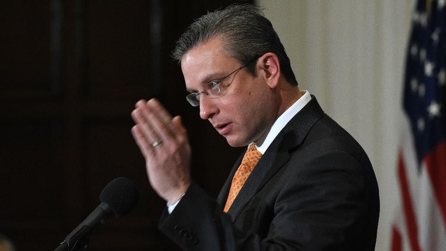 FILE - In this Dec. 16, 2015, file photo, Puerto Rico Gov. Alejandro Javier Garcia Padilla speaks at a luncheon at the National Press Club in Washington. Garcia said on Sunday, May 1, 2016, that negotiators for the U.S. territory's government have failed to reach a last-minute deal to avoid a third default and that he has issued an executive order to withhold payment. (AP Photo/Sait Serkan Gurbuz, File)