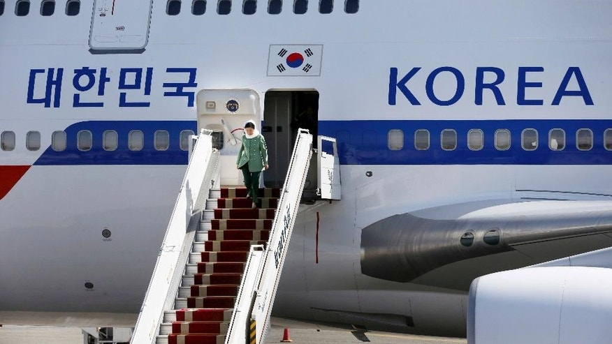 South Korean President Park Geun-hye leaves her plane upon arrival at Mehrabad Airport in Tehran, Iran, Sunday, May 1, 2016. Park Geun-hye has arrived in Tehran in the first such high-level visit since the two nations established diplomatic ties in 1962. (AP Photo/Vahid Salemi)