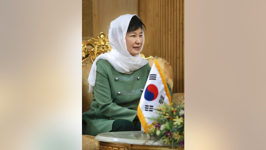 South Korean President Park Geun-hye arrives at Mehrabad Airport in Tehran, Iran, Sunday, May 1, 2016. Park Geun-hye has arrived in Tehran in the first such high-level visit since the two nations established diplomatic ties in 1962. (AP Photo/Vahid Salemi)