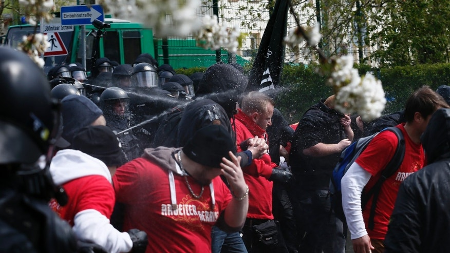 May 1, 2016: German police use pepper spray against right-wing protestors during a demonstration in the town of Plauen, Germany. (Reuters)