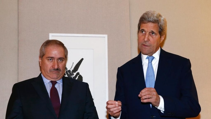 U.S. Secretary of State John Kerry, right, talks to the media next to Jordanian Foreign Minister Nasser Judeh, left, during a bilateral meeting on Syria in Geneva, Switzerland, Sunday, May 1, 2016. Kerry has appealed once more to his Russian counterpart for assistance in containing and reducing the violence, particularly around the Syrian city of Aleppo. (Denis Balibouse/Pool via AP)