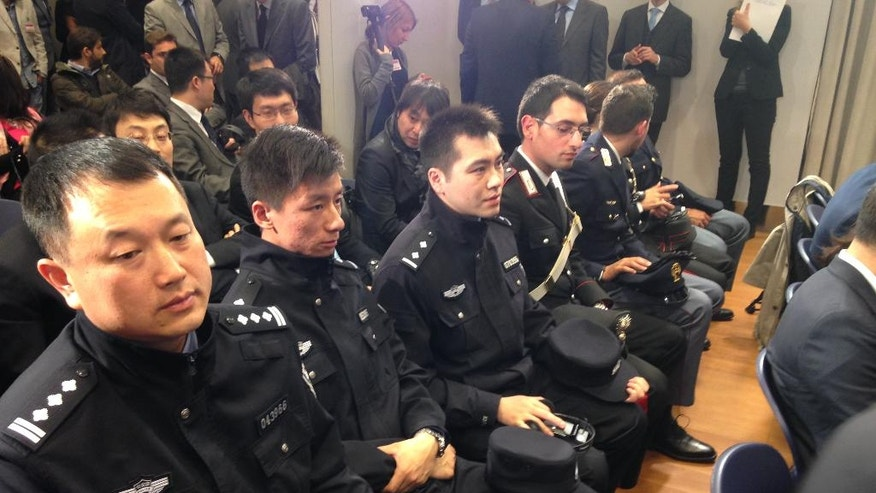 Chinese Police officers attend a news conference at the Italian Interior Ministry headquarters in Rome Monday, May 2, 2016. Chinese policemen are in Italy to start patrols with Italian officers in Rome and Milan in a two-week experiment. Interior Minister Angelino Alfano says the aim is to make Chinese tourists feel safe and notes it's the first time China sent police to Europe for such a project. (AP Photo/Paolo Santalucia)