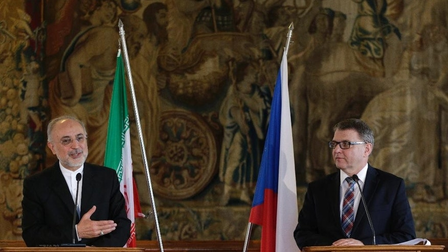 Czech Republic's foreign minister Lubomir Zaoralek, right, and Iran's vice president and nuclear chief Ali Akbar Salehi, left, address media during a press conference in Prague, Czech Republic, Monday, May 2, 2016. (AP Photo/Petr David Josek)
