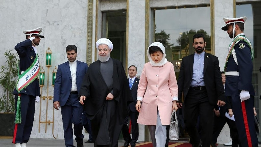 "Iranian President Hassan Rouhani, center left, and his South Korean counterpart Park Geun-hye, center right, leave Saadabad Palace after their meeting in Tehran, Iran, Monday, May 2, 2016. Rouhani met with visiting South Korean President Park Geun-hye and said Iran seeks a world free of weapons of mass destruction, ""especially nuclear"" weapons. (AP Photo/Ebrahim Noroozi)"
