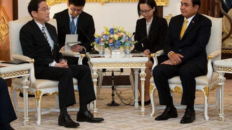 Thailand's Prime Minister Prayuth Chan-ocha, right, sits with Japan's Foreign Minister Fumio Kishida during their meeting at Government House in Bangkok, Thailand, Monday, May 2, 2016. (AP Photo/Mark Baker, Pool)