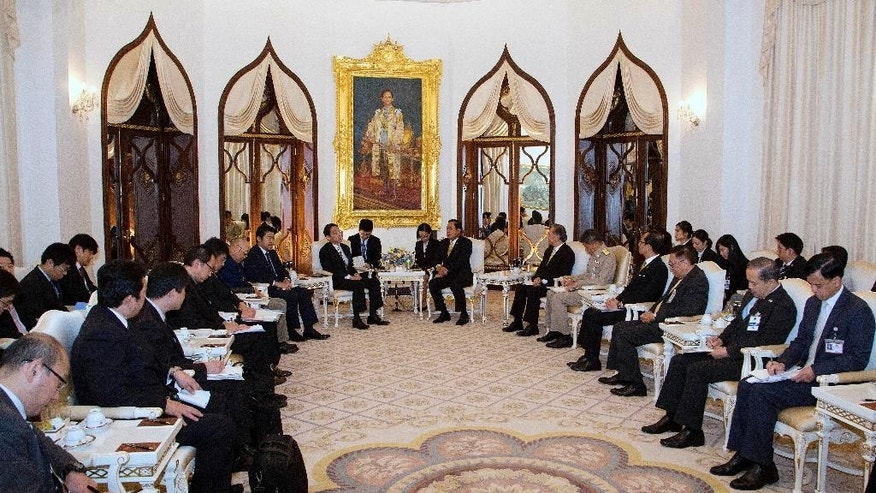 Thailand's Prime Minister Prayuth Chan-ocha, center right, sits with Japan's Foreign Minister Fumio Kishida, center left, and their delegations for talks at Government House in Bangkok, Thailand, Monday, May 2, 2016. (AP Photo/Mark Baker, Pool)