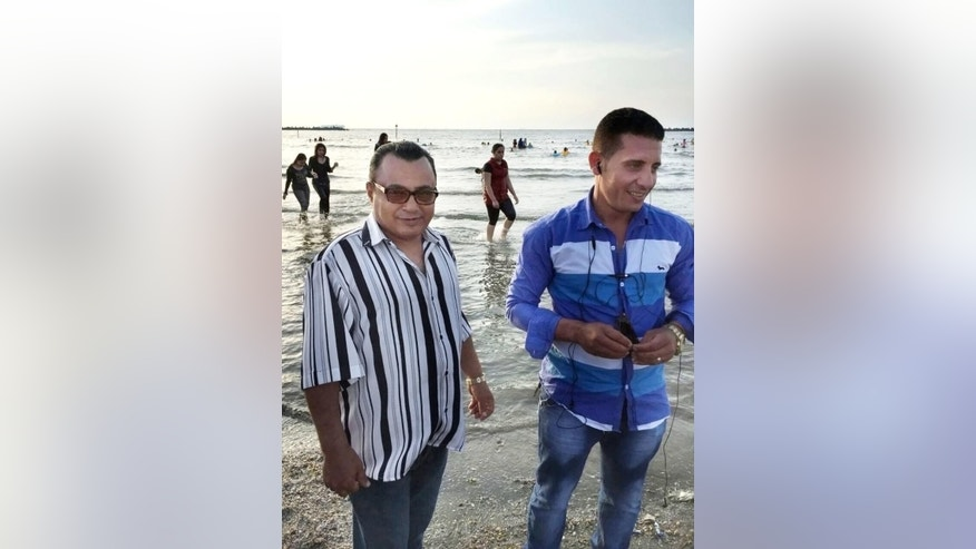 This undated handout image provided by a family member shows 62-year-old Tareq Saad, left, and his son-in-law Salah Ali, two of the five slain men shot by Egyptian police last month in relation to the death of Italian Ph.D. student Guilio Regeni. The Egyptian police announced it had killed them along with three others specialized in kidnapping and robbing foreigners and while searching the gang leader's home, came upon Guilio Regeni's bag. (Courtesy of Rasha Tareq Saad via AP)