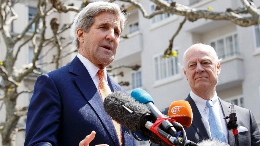 U.S. Secretary of State John Kerry, left, standing next to the UN Special Envoy for Syria Staffan de Mistura, right, speaks to the media during a press briefing after their meeting on Syria in Geneva, Switzerland, Monday, May 2, 2016. (Salvatore Di Nolfi/Keystone via AP)