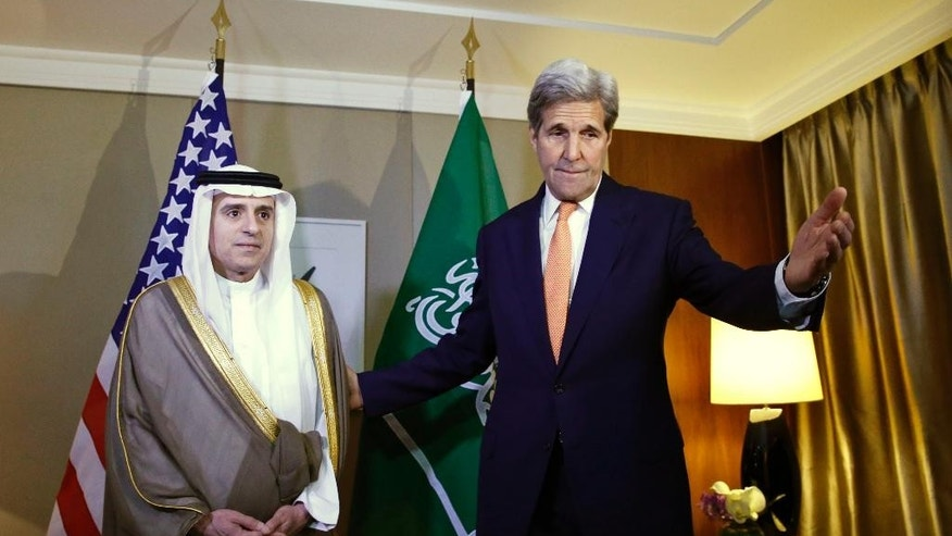 U.S. Secretary of State John Kerry, right, gestures next to Saudi Foreign Minister Adel al-Jubeir, left, during a meeting on Syria in Geneva, Switzerland, Monday, May 2, 2016. (Denis Balibouse/Pool Photo via AP)