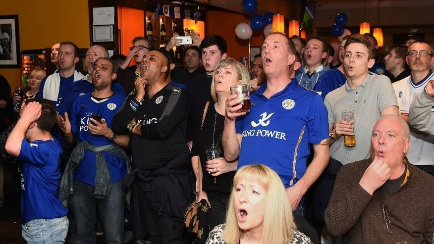 Leicester City fans react as they watch the Chelsea versus Tottenham Hotspur English Premier League soccer match at the Local Hero public house in Leicester, central England, Monday May 2, 2016. (Joe Giddens/PA via AP) UNITED KINGDOM OUT