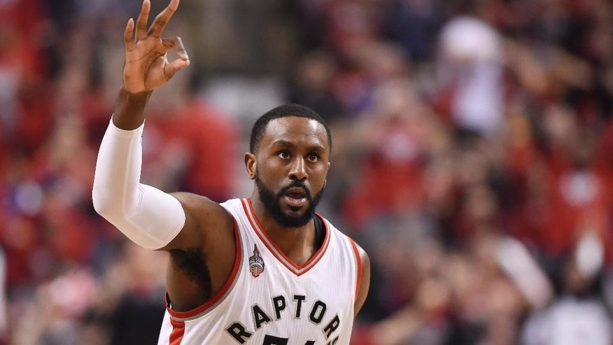 Toronto Raptors forward Patrick Patterson celebrates after scoring a three-pointer during the second half of Game 7 of round one NBA playoff basketball action against the Indiana Pacers in Toronto on Sunday, May 1, 2016. (Frank Gunn/The Canadian Press via AP)
