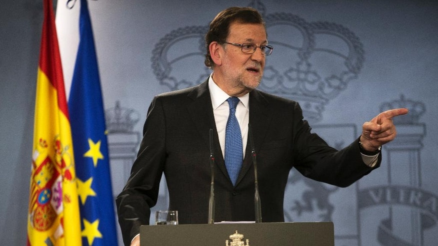 Spain's acting Prime Minister Mariano Rajoy gestures during a news conference after his meeting with Spain's King Felipe IV, at the Moncloa palace in Madrid, Tuesday, April 26, 2016. King Felipe IV is wrapping up two days of talks with political party leaders in a last-ditch bid to snap a four-month deadlock in finding a candidate capable of forming a government, but another election looks more likely. (AP Photo/Francisco Seco)