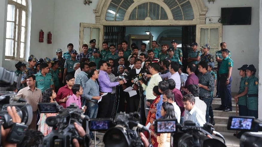 Prosecutor, Sultan Mahmud Simon, center, wearing black coat, talks to the media in front of a special war crimes court after the court sentenced four men to death in Dhaka, Bangladesh, Tuesday, May 3, 2016. The four men were sentenced to death to death for killing, torture, arson and looting during the nation's independence war against Pakistan in 1971. (AP Photo)