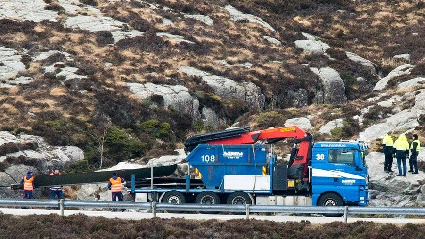 Helicopter rotor blades are loaded onto a truck following the Friday April 29 helicopter crash on the coast of Norway near Bergen, Sunday May 1, 2016.  Emergency crews salvaged the wrecked fuselage of the Airbus helicopter from the sea Saturday along with the flight recorders, and retrieved the rotor blades following the crash which killed the 13 people on board. (Torstein Boe / NTB scanpix via AP) NORWAY OUT