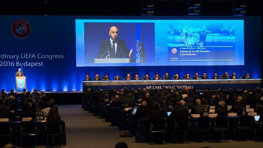 FIFA President Gianni Infantino, left, delivers his address during the 40th Ordinary Congress of the Union of European Football Associations, UEFA, in Budapest, Hungary, Tuesday, May 3, 2016.  (Tibor Illyes/MTI via AP)