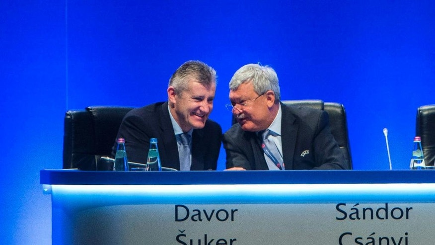 President of the Croatian Soccer Federation, HNS, Davor Suker, left, and President of the Hungarian Soccer Federation, MLSZ, Sandor Csanyi chat during the 40th Ordinary Congress of the Union of European Football Associations, UEFA, in Budapest, Hungary, Tuesday, May 3, 2016.  (Tibor Illyes/MTI via AP)