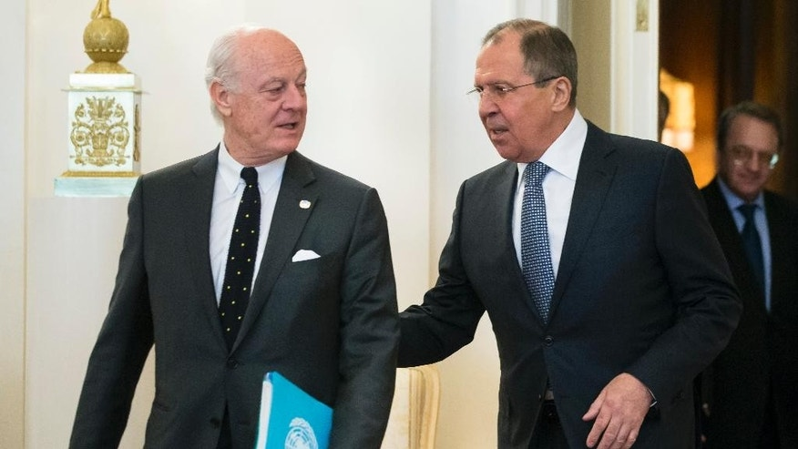 Russian Foreign Minister Sergey Lavrov, right, welcomes Staffan de Mistura, UN Special Envoy of the Secretary-General for Syria, as they arrive for their talks in Moscow, Russia, Tuesday, May 3, 2016. The United Nations' envoy for Syria and Russia's foreign minister have began talks in Moscow about strengthening the faltering cease-fire in Syria. (AP Photo/Alexander Zemlianichenko)