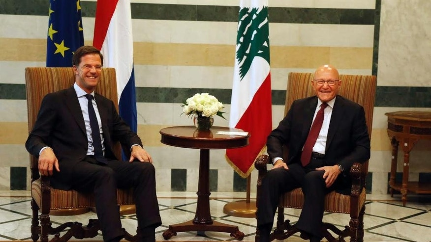 Lebanese Prime Minister Tammam Salam, right, and Dutch Prime Minister Mark Rutte, left, smile during their meeting at the government palace in downtown Beirut, Lebanon, Tuesday, May 3, 2016. (Mohamed Azakir/Pool via AP)