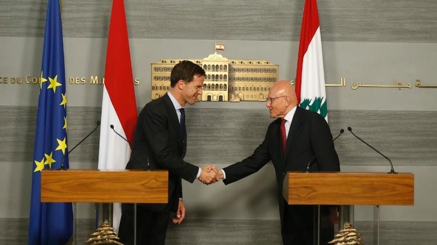 Lebanese Prime Minister Tammam Salam, right, shakes hands with Dutch Prime Minister Mark Rutte, after a joint press conference at the government palace in downtown Beirut, Lebanon, Tuesday, May 3, 2016. (Mohamed Azakir/Pool via AP)