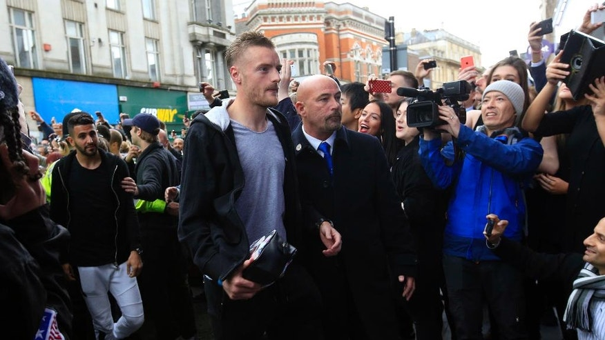 Leicester City's Jamie Vardy arrives at San Carlo Pizzeria for a celebratory lunch in Leicester, England Tuesday May 3, 2016. Leicester  clinched the most improbable title of the Premier League era when second-place Tottenham was held to a 2-2 draw at Chelsea on Monday night.  (Jonathan Brady/PA via AP)  UNITED KINGDOM OUT