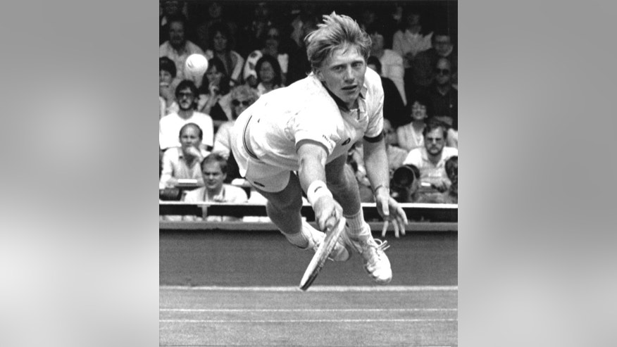 FILE - In this July 1, 1985 file photo, Boris Becker, of West Germany, dives to make a return from his opponent Joakim Nystrom, of  Sweden, in the men's singles third round play at the All England Lawn Tennis Championships in Wimbledon, London. English soccer team Leicester City's achievement of winning the Premier League has drawn comparisons with other upsets in sporting history including Becker's victory as a 17-year-old at Wimbledon in 1985. (AP Photo/John Redman, File)