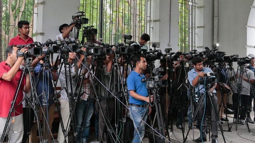 Bangladeshi journalists cover proceedings  outside a court in Dhaka, Bangladesh, Tuesday, May 3, 2016. Tuesday marks World Press Freedom Day. (AP Photo/ A.M. Ahad)