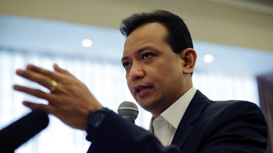 Philippine Sen. and vice presidential candidate Antonio Trillanes IV gestures as he answers questions during a forum with the Foreign Correspondents Association of the Philippines in Manila, Philippines Tuesday, May 3, 2016. Trillanes alleged that the Philippine presidential front-runner Rodrigo Duterte had a large sum of money in an undeclared bank account. The allegations have not been resolved Monday, allowing the issue to hang over the final week of the closely fought presidential race. (AP Photo/Aaron Favila)