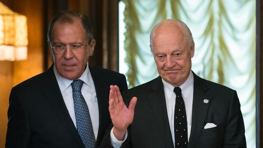 Russian Foreign Minister Sergey Lavrov, left, and Staffan de Mistura, UN Special Envoy of the Secretary-General for Syria, enter a hall for their talks in Moscow, Russia, Tuesday, May 3, 2016. The United Nations' envoy for Syria and Russia's foreign minister have began talks in Moscow about strengthening the faltering cease-fire in Syria. (AP Photo/Alexander Zemlianichenko)