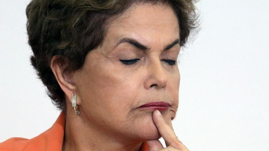 Brazil's President Dilma Rousseff pauses during a ceremony launching an agricultural plan that allocates billions of dollars to farmers at Planalto presidential palace in Braslia, Brazil, Wednesday, May 4, 2016. Brazil's attorney general has asked the country's highest court to authorize an investigation into embattled Rousseff over obstruction of justice allegations, according to major Brazilian news organizations. (AP Photo/Eraldo Peres)