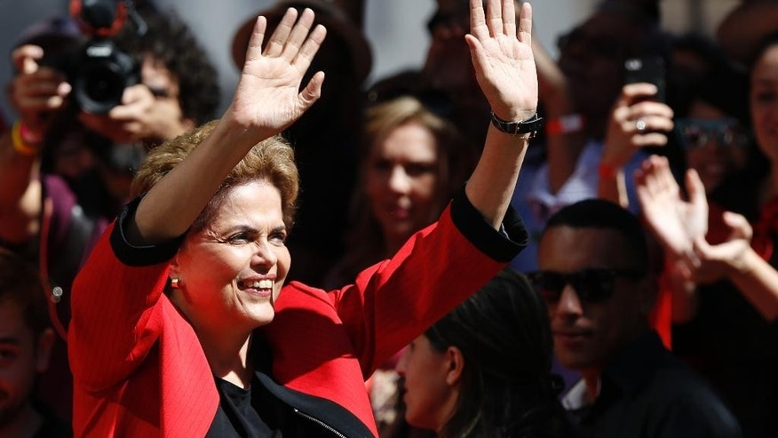 Brazil's President Dilma Rousseff gestures to supporters during a May Day rally in Sao Paulo, Brazil, Sunday, May 1, 2016. President Rousseff is facing impeachment over allegations her administration violated fiscal laws. (AP Photo/Andre Penner)