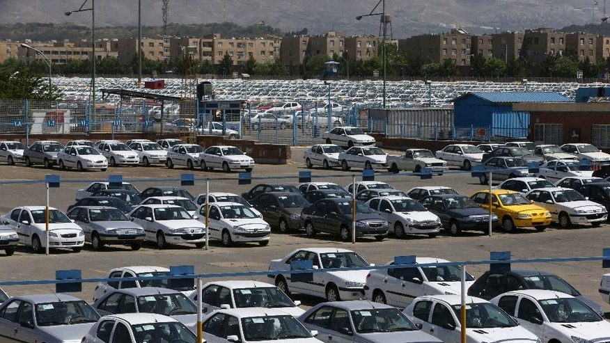 "In this picture taken on April 25, 2015, cars are parked in a depot at the state-run Iran Khodro automobile manufacturing plant, just outside Tehran, Iran. Chevrolet, the U.S. car brand once advertised as the ""Heartbeat of America,"" won't be rolling new models through the streets of Iran anytime soon despite the recent lifting of sanctions under a nuclear deal with world powers. (AP Photo/Vahid Salemi)"
