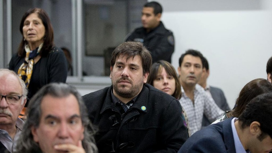 Guillermo Roisinblit, who was born in captivity to Patricia Roisinblit during Argentina's dictatorship and raised by another family, attends the trial of the man who raised him, Francisco Gomez, and two others in Buenos Aires, Argentina, Wednesday, May 4, 2016. The trial investigates Omar Graffigna, who was the head of Argentina's Air Force during the military dictatorship, and two of his subordinates for the forced disappearances of Patricia Roisinblit, who was eight months pregnant with Guillermo, and her husband Jose Manuel Perez Rojo. (AP Photo/Natacha Pisarenko)