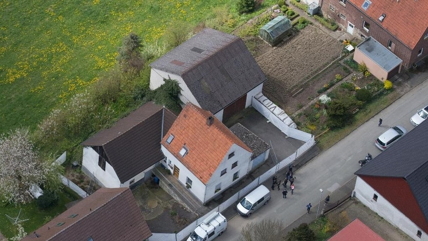 An aerial photo of the house of the incriminated couple in Hoexter-Bosseborn, Germany, Wednesday, May 4,  2016, where a couple in custody for allegedly holding a woman captive for nearly two months and abusing her so badly that she died are believed also to have killed and dismembered a second woman, German authorities said Tuesday. (Friso Gentsch/dpa via AP)