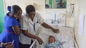 Nurses at Kenyatta National Hospital attends to Dealeryn Saisi Wasike, the nearly 6-month-old girl who was rescued early Tuesday from the rubble of a building that collapsed last week, lies in a hospital bed at Kenyatta National Hospital in Nairobi, Kenya Wednesday, May 4, 2016. The girl was brought to the hospital after being found in the ruins of the seven-story building that collapsed Friday night but had no physical injuries and was being treated for dehydration, according to a hospital spokesman. (AP Photo/Sayyid Abdul Azim)