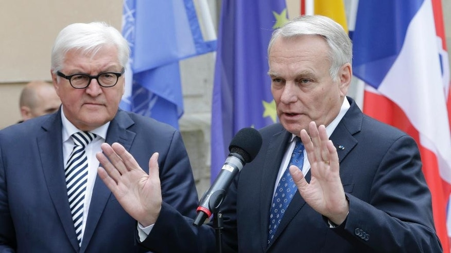 Germany's Foreign Minister Frank-Walter Steinmeier, left, and France's Foreign Minister Jean-Marc Ayrault give a statement prior to a meeting on the situation in Syria in Berlin, Germany, Wednesday, May 4, 2016. (AP Photo/Ferdinand Ostrop)