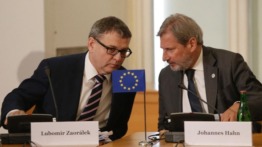 Czech Republic's foreign minister Lubomir Zaoralek talks to EU commissioner for european neighbourhood policy Johannes Hahn during a meeting of Visegrad 4 foreign ministers with their counterparts from six post-Soviet republics in Prague, Czech Republic, Wednesday, May 4, 2016. (AP Photo/Petr David Josek)