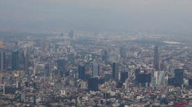 FILE - In this March 18, 2016, file photo, view shows Mexico City covered in smog a day after a pollution alert was lifted. Mexico City authorities have declared a pollution alert on Monday, May 2, 2016, after smog rose to 1½ times acceptable limits for second time in less than a month. (AP Photo/Rebecca Blackwell, File)