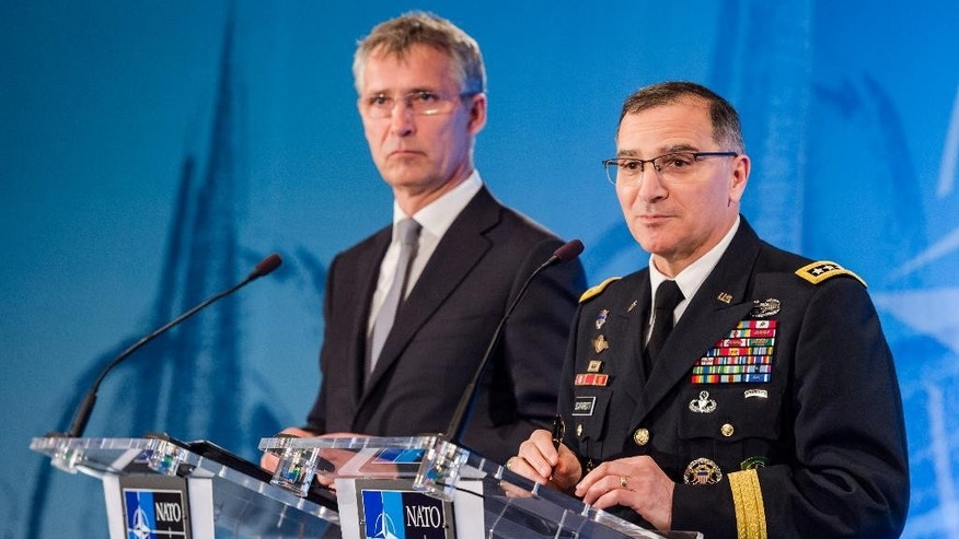 NATO Secretary General Jens Stoltenberg, left, and NATO's supreme allied commander Europe U.S. Army General Curtis M. Scaparrotti.
