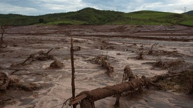 FILE - This is  Nov. 23, 2015  file photo of debris awash in mud in Bento Rodrigues, Brazil. After obliterating several towns, the tide of mud and debris surged forward, blanketing a wide swath of land and cascading into the Doce River.  Shares in miner BHP Billiton Ltd tumbled Wednesday May 4, 2016  after Brazil's Federal Public Prosecution said it had launched a $43 billion civil suit for a dam break that killed 19 people and caused the worst environmental disaster in the country's history.(AP Photo/Leo Correa, File)