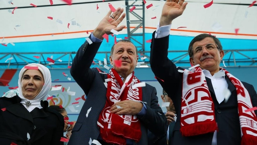 Turkey's President Recep Tayyip Erdogan, center, and Prime Minister Ahmet Davutoglu, right, in April.